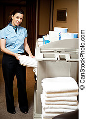 Housekeeping in charge pulling out the bath towel from the...