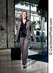 Stylish businesswoman entering the hotel - Stylish...