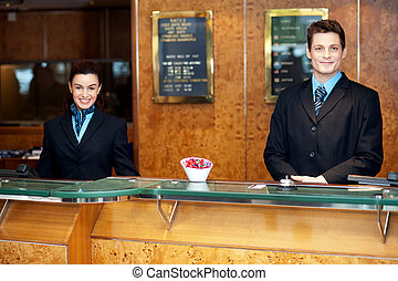 Front desk colleagues posing for a picture. Smiling...
