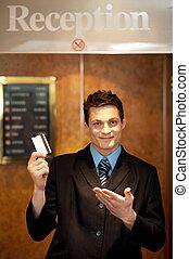 Snap shot of handsome guy holding cash card