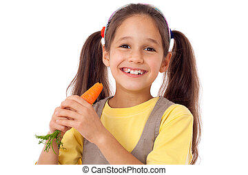 Girl eating the carrot - Smiling girl eating the carrot,...