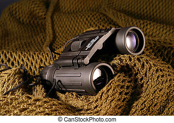Military spyglass - A military black spyglass laid on a...