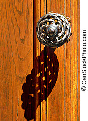 Old handle - Old-style handle on an orange wooden door
