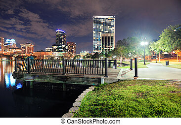 Orlando downtown dusk - Orlando downtown skyline over Lake...