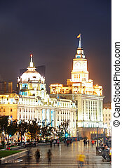Shanghai Waitan night view with historic buildings over...