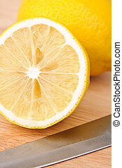 Lemon on chopping board - Half of lemon on chopping board...