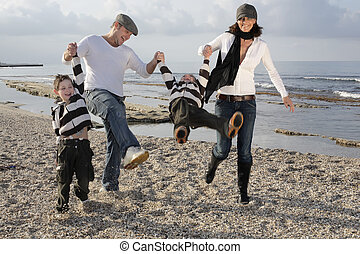 playful family on the beach
