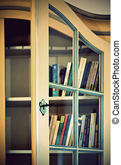 Book cupboard - yellow book cupboard in vintage style with...