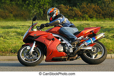 motorcycling - motorcyclist cornering at speed