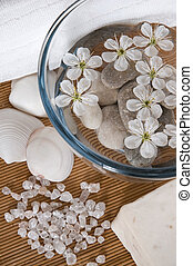 white wellness products with cherry flowers