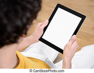 Holding digital tablet with blank screen