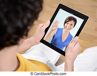 Video chat communication - Man and woman communicate through...
