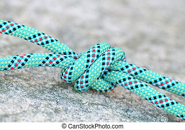 knot on a climbing rope on a granit rock