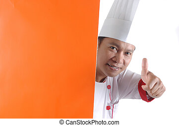 chef gives thumbs up sign with orange blank space isolated...