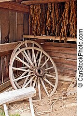 Wagon Wheels and Tobacco - Sepia toned antique wagon wheels...