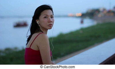 chinese business woman listening music