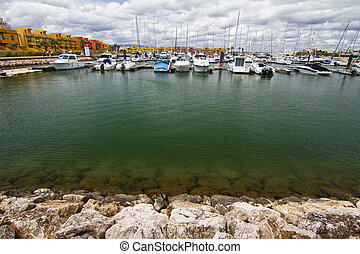 marina with recreation boats