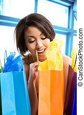 Shopping woman - A shot of a beautiful black woman looking...
