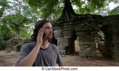 Talking with phone in jungle