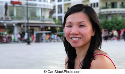 Happy chinese girl in city