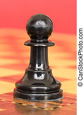 Black pawn - Close up of isolated black figure