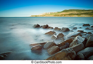 Seascape with Kimmeridgian rock ledges extending out to sea...
