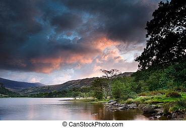 Beautiful sunrise over Llyn Gwynant in Snowdonia National...