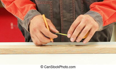 Measure tape - Carpenter working with tape measure,marking...