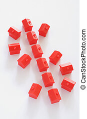 Real Estate Concept - Dollar sign made up of red houses on...