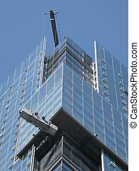 Window Washers - Window cleaners cleaning the glass facade...