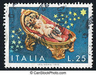 Christ Child in Cradle - ITALY - CIRCA 1972: stamp printed...