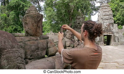 visitor takes picture in angkor