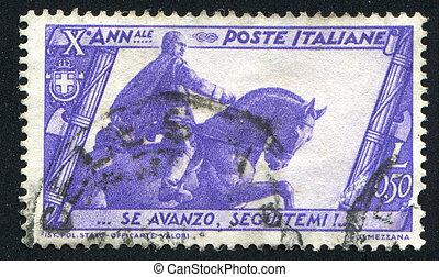 Mussolini statue in Bologna - ITALY - CIRCA 1932: stamp...
