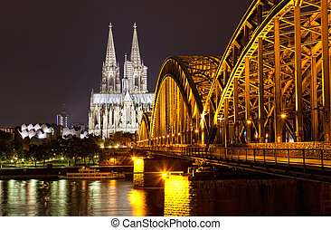 Cologne Gothic Cathedral at night as seen from the Rehin