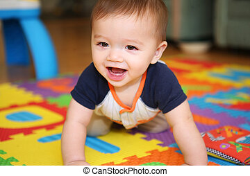 A cute baby playing - A cute young boy baby playing inside...