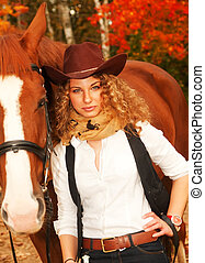 Beautiful cowgirl with her red horse. soft focus - Beautiful...