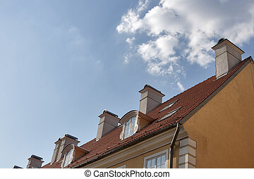 Riga roof with chimneys against cloudy sky. Latvia.