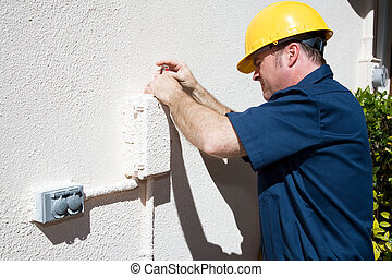 Electrical or Cable Repairman - Repairman opening an outdoor...