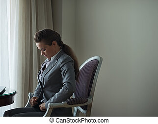 Business woman in hotel room. Business trip