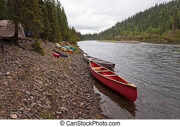Tents and canoes at McQuesten River Yukon Canada - Tent camp...