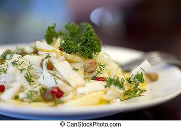 Mixed vegetables on  a plate against dark background
