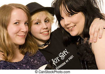 three happy young girls on white background