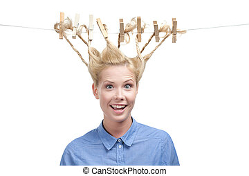 Woman with creative hairstyle of clothespins