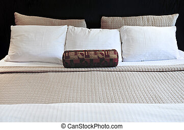 Comfortable bed in upscale hotel close up