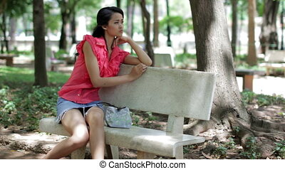 Depressed girl sitting park bench