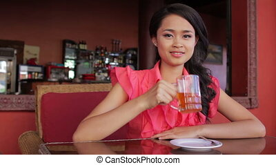 gorgeous asian woman in cafe