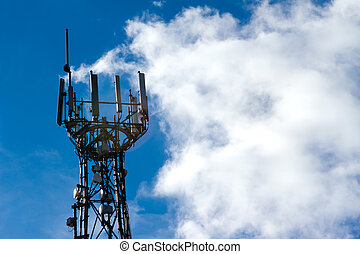 Mobile phone mast with a blue sky behind