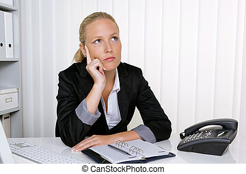 pensive business woman in office - a pensive businesswoman...
