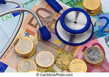 stethoscope and banknotes - your notes and euro coins with a...