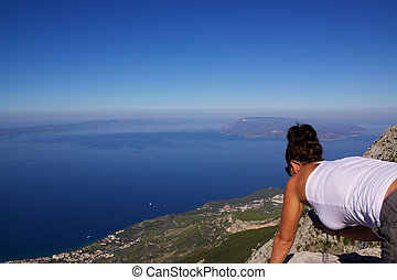 Biokovo panorama - Girl looking down from mountain in...